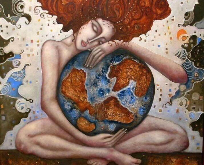nainen halaa maapalloa