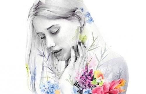 naisella on kukkia
