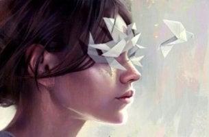 naisella paperiorigameja silmillä