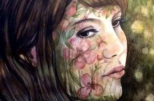 naisella kukkia kasvoissaan