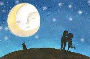 pariskunta ja kissa kuun alla