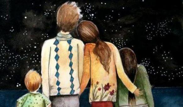 perhe on ulkona katsomassa tähtiä