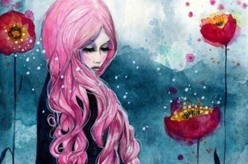 naisella on vaaleanpunaiset hiukset