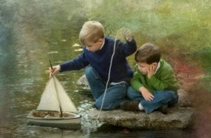 Veneellä leikkivät pojat