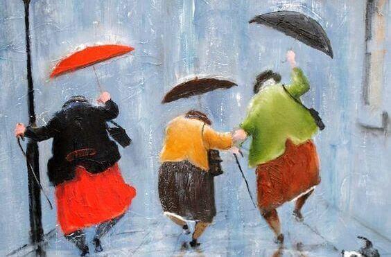 mummot tanssivat sateessa sateenvarjojen kanssa