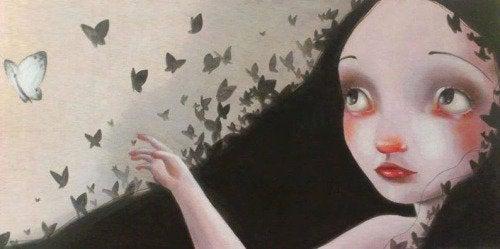 Tyttö katselee perhosia