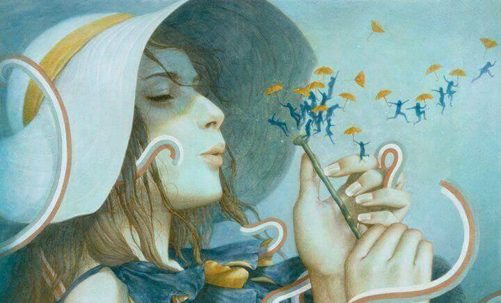 nainen puhaltaa kukan josta tulee pieniä ihmisiä