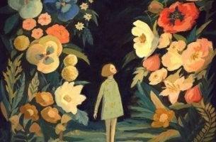 tyttö suurten kukkien ympäröimänä