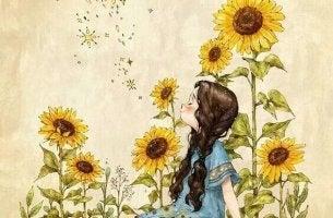 tyttö oppii auringonkukilta