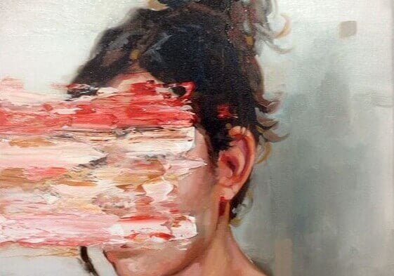 naisen naama on sutattu maalilla