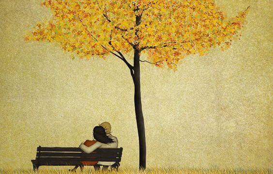 pariskunta penkillä puun alla