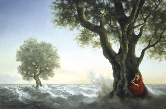 Nainen istuu puun juurella