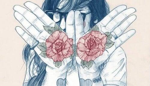ruusut tatuoituina käsiin