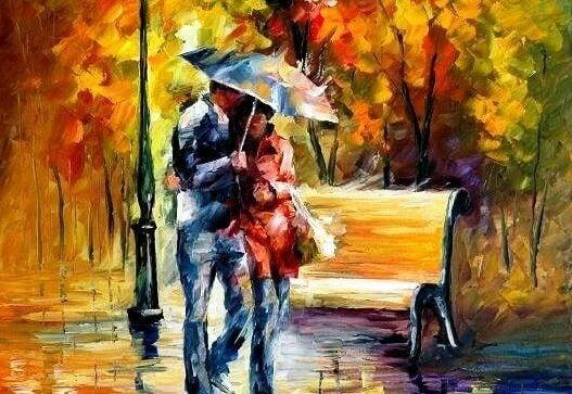 Sateenvarjon alla kulkeva pari