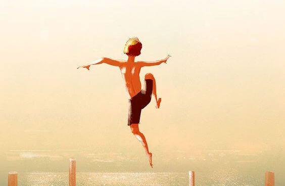 poika hyppää laiturilta veteen