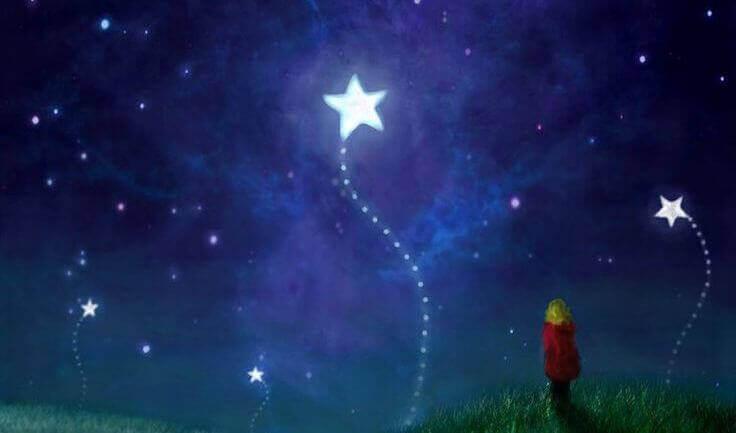 tyttö katselee tähtiä