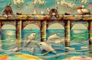 tyttö katselee delfiinejä
