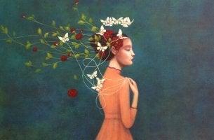 naisella kukkia ja perhosia päässään