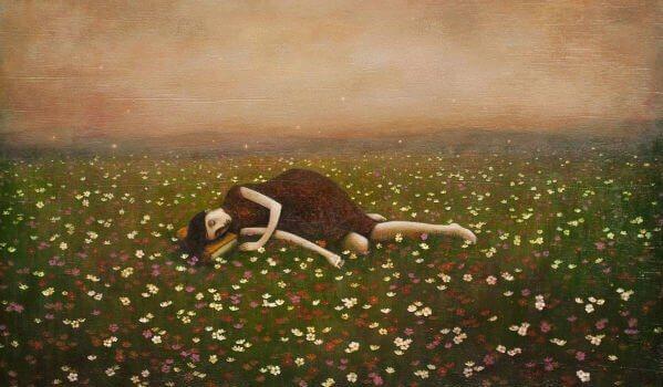 surullinen tyttö makaa maassa