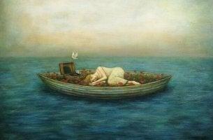 Veneessä lepäävä nainen