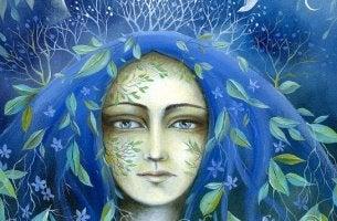 naisella siniset hiukset joissa lehtiä