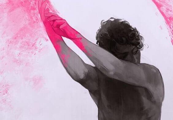 mies ja vaaleanpunaista väriä