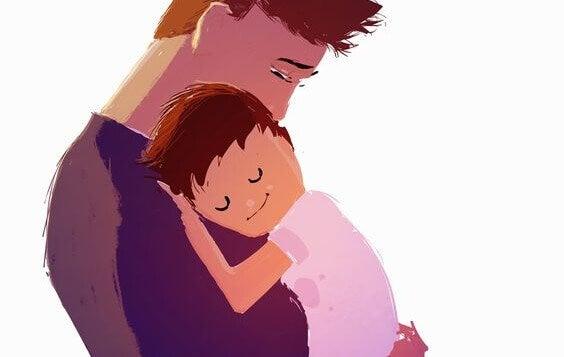 Onnellinen poika isän sylissä