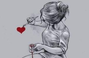 tyttö maalaa sydämen seinään