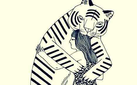 tiikeri ja nainen halaavat
