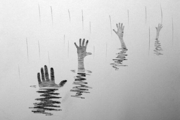 käsiä kurottelee vedestä