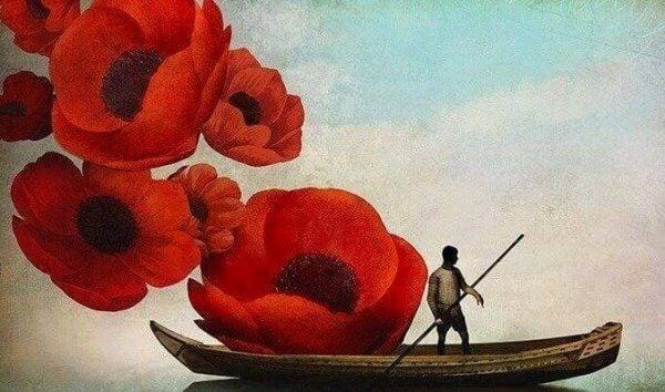mies paatissa ja kukat