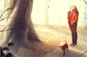 nainen kävelyllä koiran kanssa