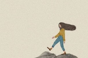 nainen kävelee kiveltä kivelle