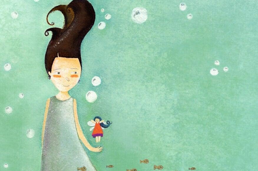 tyttö ja pieni tyttö veden alla