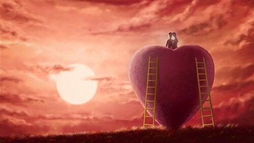 iso sydän ja pariskunta istuu sen päällä