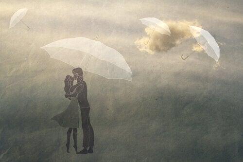 pariskunta ja lentävät sateenvarjot