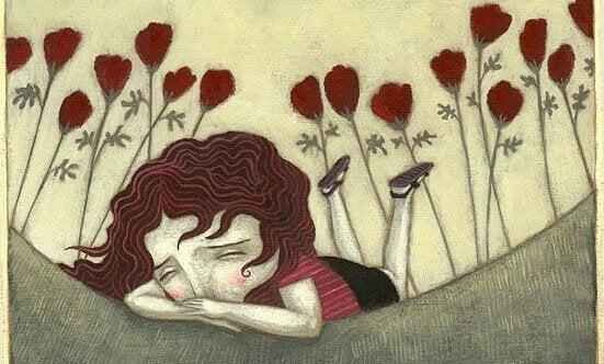 tyttö itkee yksin ulkona