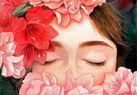 nainen kukkien takana