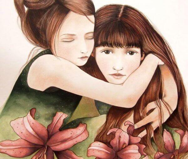kaksi tyttöä halaa