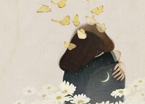 kaksi ihmistä halaa perhosten ja kukkien keskellä