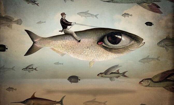 mies ratsastaa isosilmäisellä kalalla