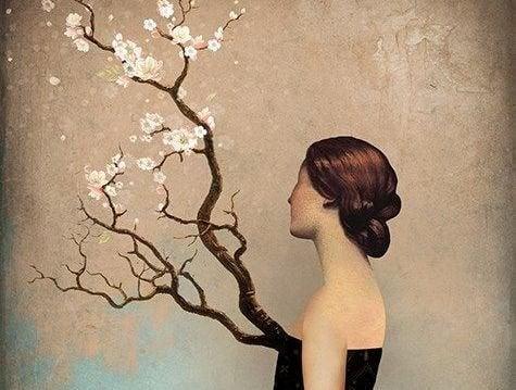 naisella kasvaa puu rinnasta