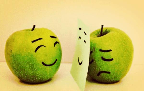 surullinen omena esittää iloista
