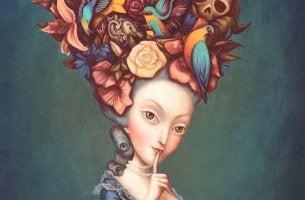 naisella on kukkia ja lintuja hiuksissaan
