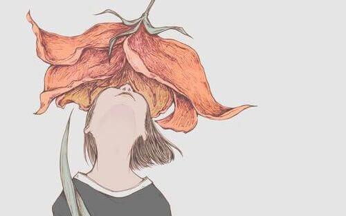 tyttö on suuren kukan sisässä