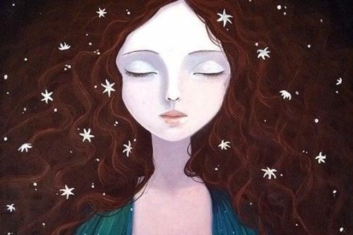 naisella tähtiä hiuksissaan