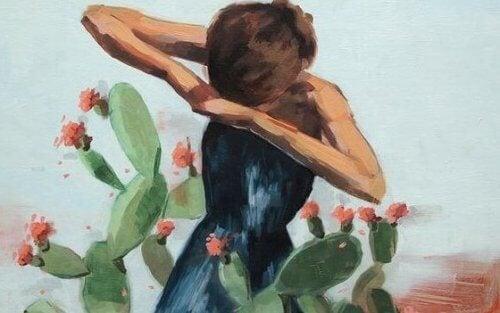 nainen keskellä kaktusta