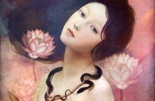 nainen, lootukset ja käärme