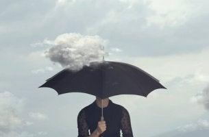musta sateenvarjo ja pikku pilvi