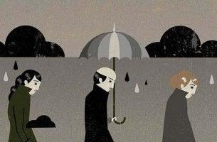 masentuneet ihmiset sateessa